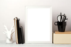 Frame mock up on table. White frame mock up with pencil and notebook. Modern stylish interior background for social media and marketing Royalty Free Stock Photos