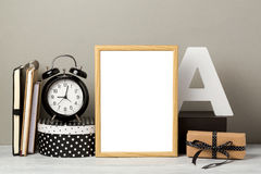 Frame mock up on table. Wooden frame mock up. Modern stylish interior background for social media and marketing Royalty Free Stock Photo