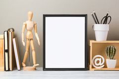 Frame mock up template. Modern workspace with blank frame mock up and office supplies. Creative desk interior background for socila media and marketing Royalty Free Stock Images