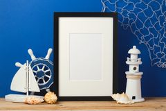 Frame mock up on wooden table. Nursery or kids room interior background Stock Images