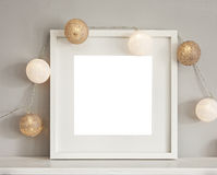 Frame mockup with baubles. Image of a mockup scene with white frame and light baubles royalty free stock image