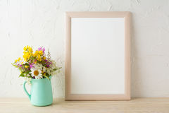 Frame mockup with flowers in mint green vase. Frame mockup with tender flowers in mint green vase. Poster white frame mockup. Empty white frame mockup for royalty free stock images