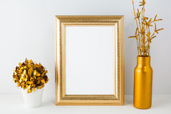 Frame mockup with golden vase Royalty Free Stock Image