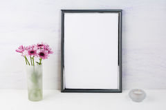 Frame mockup with lilac daisies Royalty Free Stock Images