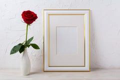 Frame mockup with red rose in elegant vase Stock Photo