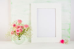 Frame mockup with roses in vase Royalty Free Stock Images