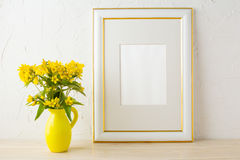 Frame mockup with small yellow flowers in stylized pitcher vase Royalty Free Stock Photos