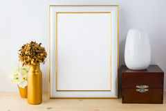 Frame mockup with vases, wooden box and golden flower pot royalty free stock photos