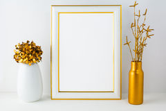 Frame mockup with white and golden vases Royalty Free Stock Photo