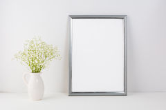 Frame mockup with white tender flowers Royalty Free Stock Photos