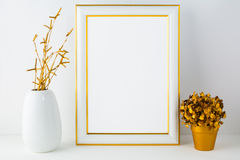 Frame mockup with white vase and golden flower pot Royalty Free Stock Photo