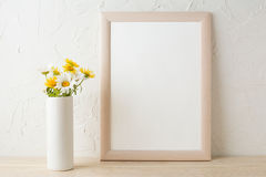 Frame mockup with white and yellow chamomiles in vase Stock Photos