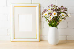 Frame mockup with wild flowers bouquet Royalty Free Stock Photo
