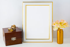 Frame mockup with wooden box and golden vase Stock Photography