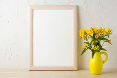 Frame mockup with yellow flowers in stylized pitcher vase Royalty Free Stock Photo