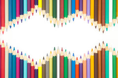 Frame of Multiple colours wooden pencils on white background. Rainbow colours of wooden pencils on white background royalty free illustration