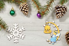 Frame from natural fir tree branches with  Christmas ornament on Stock Photo