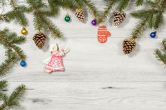 Frame from natural fir tree branches with  Christmas ornament on Royalty Free Stock Photos