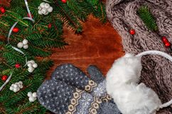 Background with Christmas tree branches, scarf, fur headphones a Stock Photo