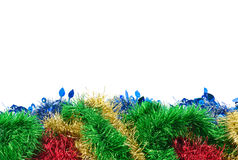 Frame with New Year`s or Christmas tinsel. New Year`s or Christmas frame of multi-colored Christmas tree tinsel Stock Photos