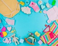 Free Frame Of Baby Clothes, Toys And Accessories On Blue Background W Stock Images - 113433644