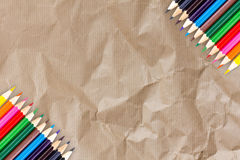 Frame Of Colour Pencils On Recycle Cardboard Texture Paper Background Stock Photos