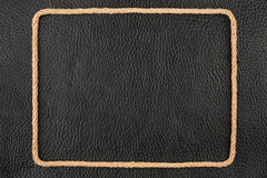 Frame Of Rope, Lies On A Background Of A Black Natural Leather Royalty Free Stock Photos