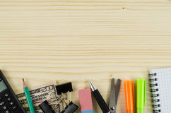 Frame of office tools on wooden table Stock Photos