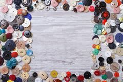 Frame of old buttons on wooden close-up horizontal top view Royalty Free Stock Photography