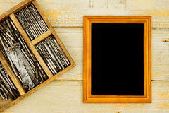 Frame with old drills in the box on a wooden Royalty Free Stock Photos