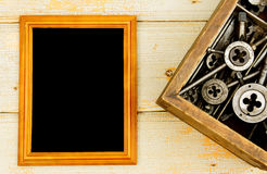 Frame with old drills in the box on a wooden Stock Photo