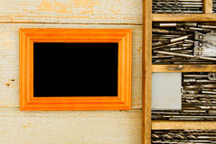 Frame with old drills in the box on a wooden Stock Photos