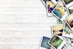 Frame with old paper and photos on wooden background. Frame with old paper and photos. Objects over wooden planks Royalty Free Stock Image