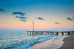 Frame of the old pier on the beach at dawn Stock Photo