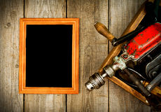 Frame with old tools (drill, mallet, saw and Royalty Free Stock Photos