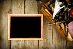 Frame with old tools (drill, mallet, saw and Royalty Free Stock Photo
