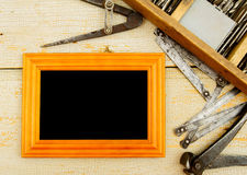 Frame with old tools (drill, pliers, ruler and Royalty Free Stock Photo