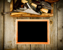 Frame with old tools (plane, hammer, scissors and Royalty Free Stock Photo