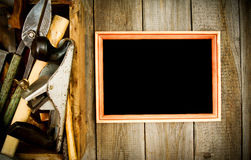 Frame with old tools (scissors, pliers, saw and Royalty Free Stock Photos