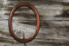 Frame on old wooden background Stock Photography