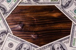 Frame of one hundred dollars bills on wooden table. Top view Stock Image
