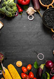 Frame of organic food. Fresh raw vegetables with black beans. Stock Photos