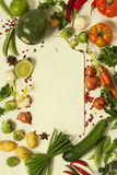 Frame of organic vegetables on white Royalty Free Stock Photos