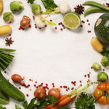 Frame of organic vegetables on white Stock Images