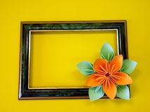 Frame and origami flower Royalty Free Stock Photography