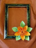 Frame and origami flower Stock Images