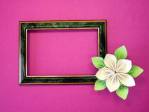Frame and origami flower Stock Image