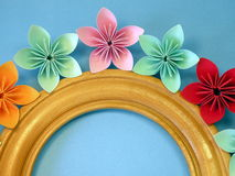 Frame and origami flowers Stock Photography