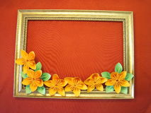 Frame and origami flowers Royalty Free Stock Photos