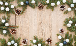 Frame out of Fir Tree Twigs and Christmas Decoration Stock Image